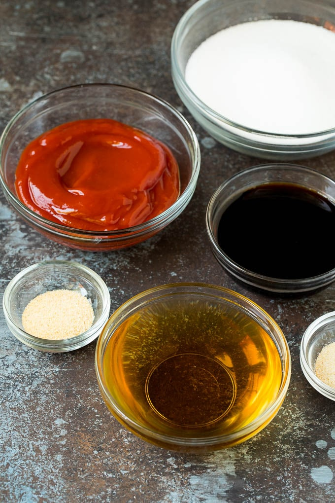 Bowls of ketchup, sugar, soy sauce, vinegar and seasonings.