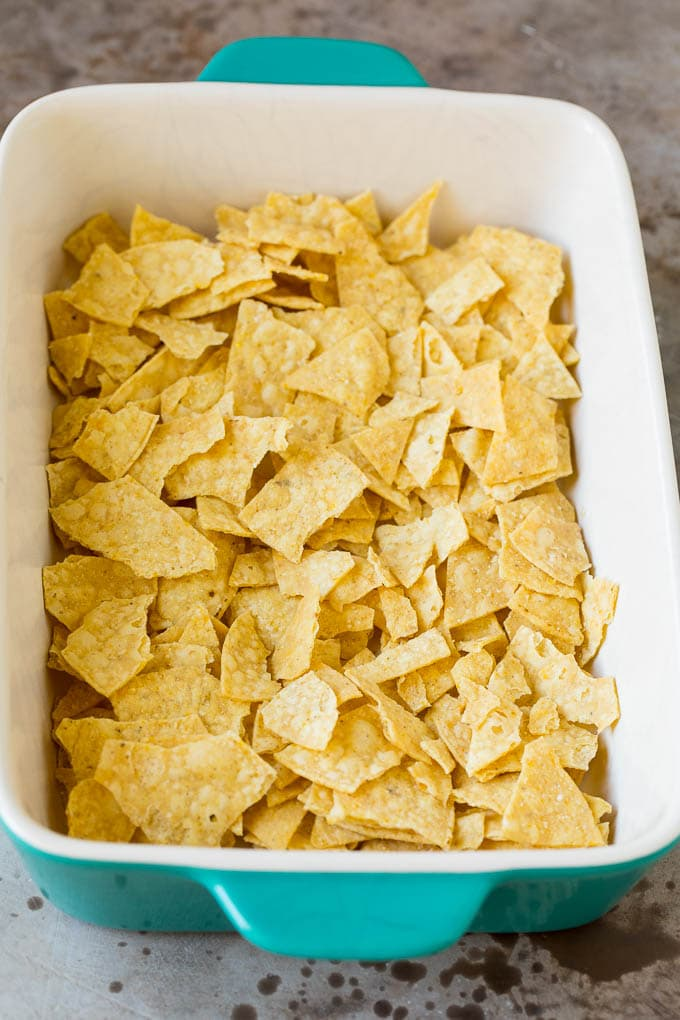 Crushed tortilla chips in a baking dish.