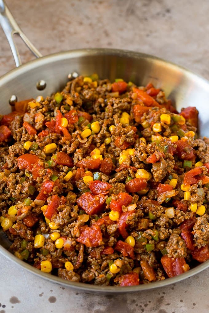 A mixture of ground beef and vegetables in a pan.