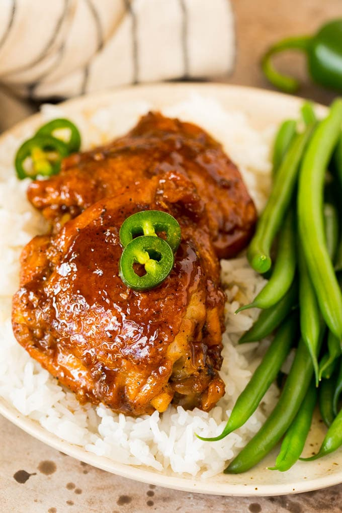 Chicken adobo served with rice and green beans.