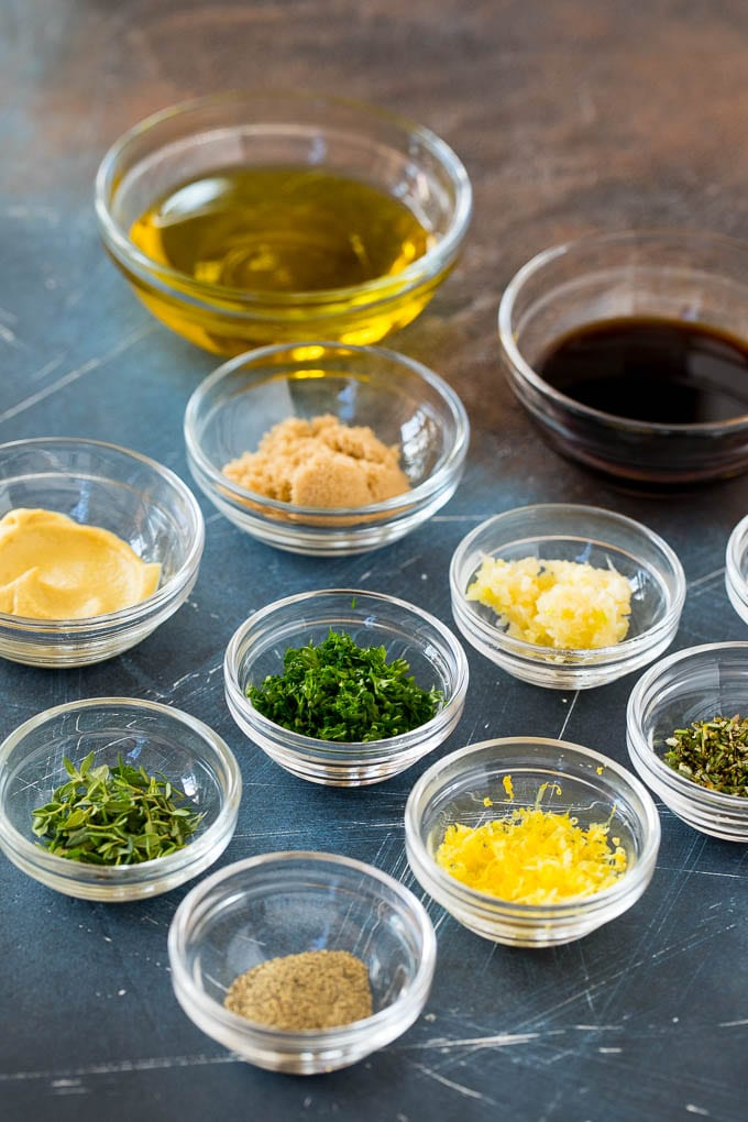 Herbs, spices and olive oil in bowls to make a marinade.