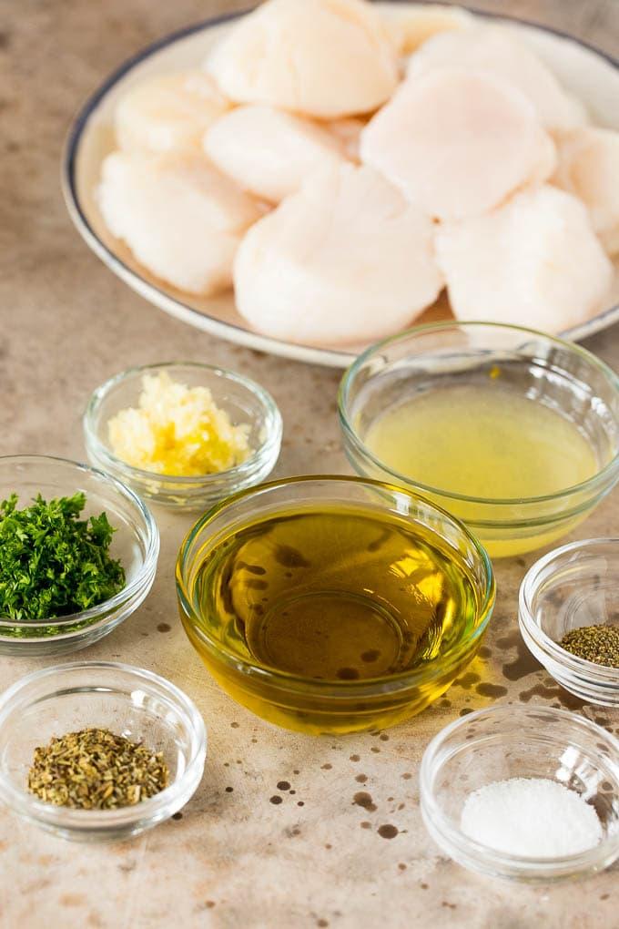 Bowls of ingredients including olive oil, parsley, lemon juice and seasonings.