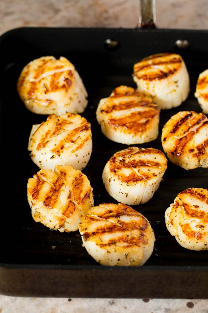 Cooked scallops on a grill pan.