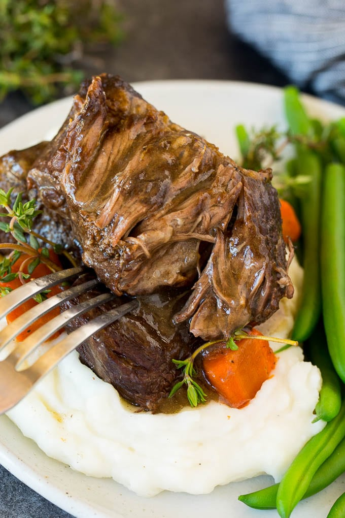 A plate of Instant Pot short ribs served over mashed potatoes.