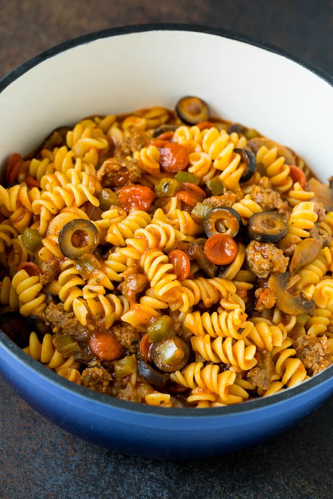 Cooked pasta with meat and vegetables in a pot.