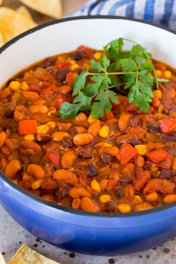 A pot of vegetarian chili topped with fresh cilantro.