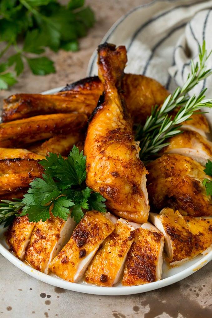 Carved chicken on a serving platter.