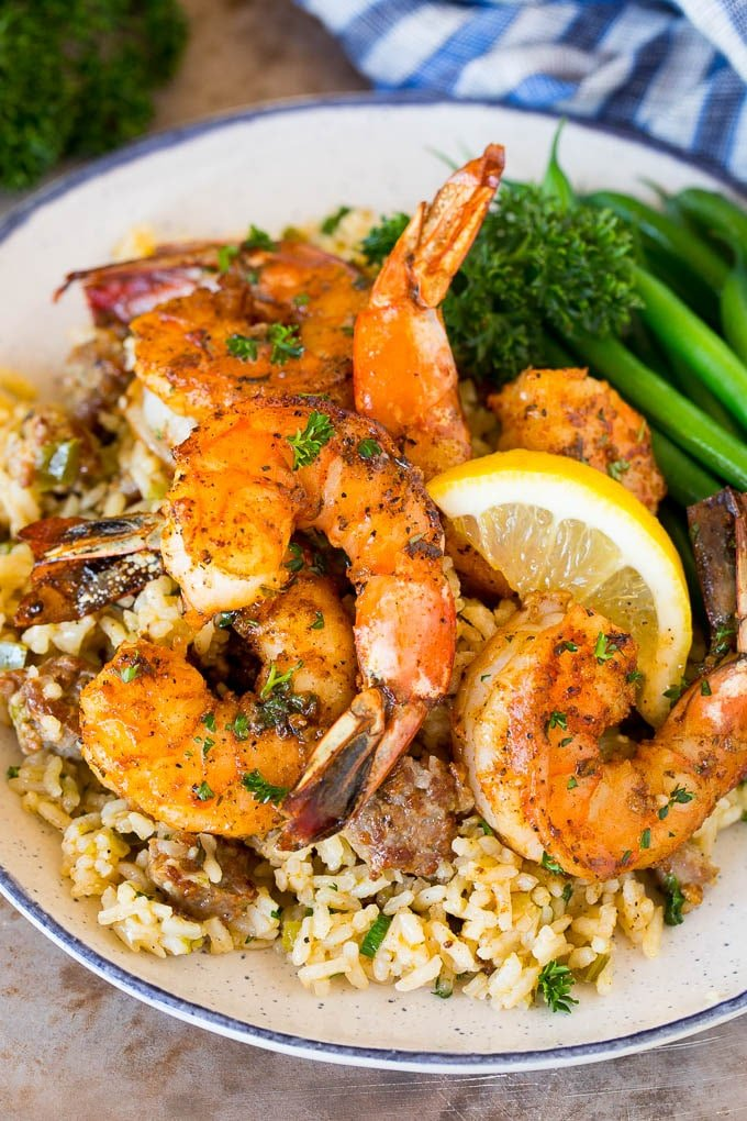 Cajun shrimp served over rice with green beans.