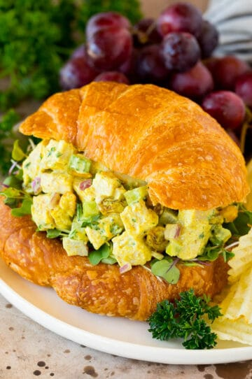 Curry chicken salad served on a croissant.