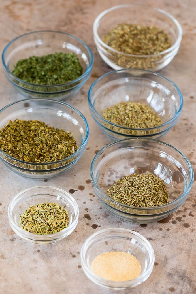 Small bowls of various herbs and spices.