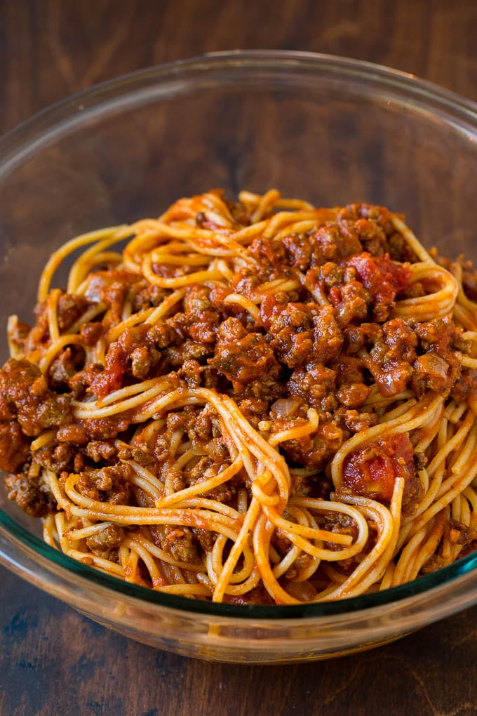 Spaghetti tossed with meat sauce in a bowl.