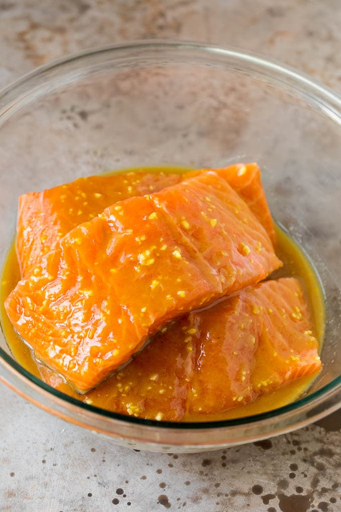 Salmon in a bowl of marinade.