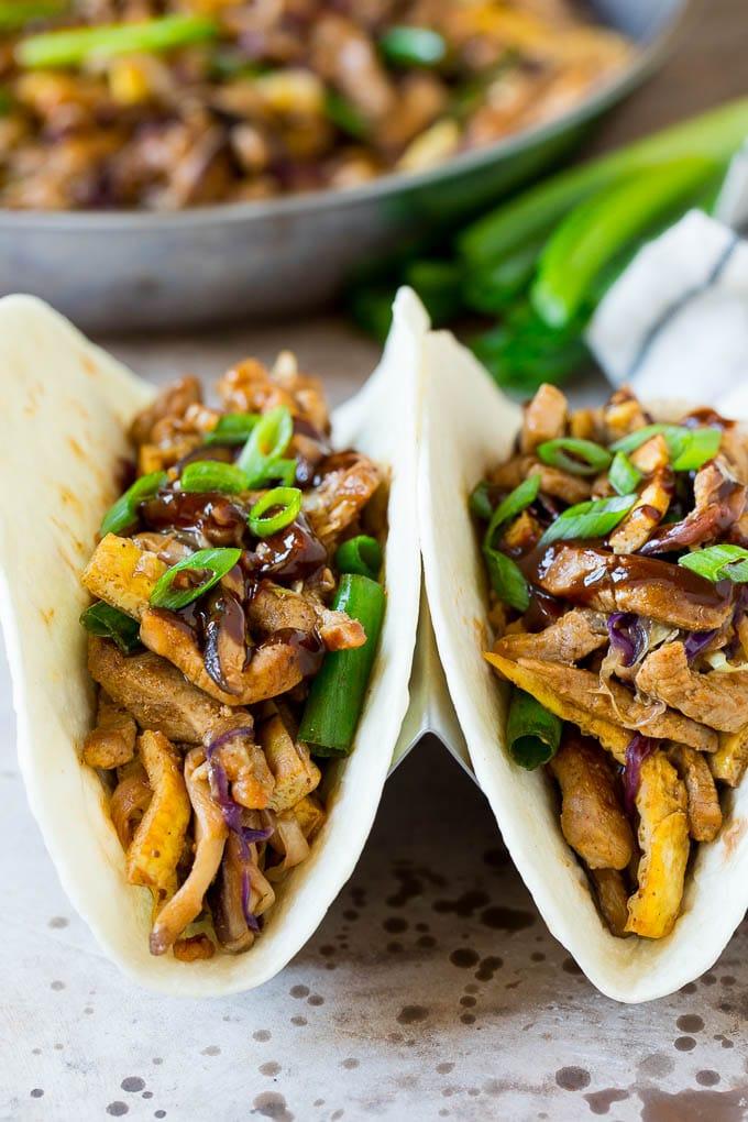 Moo shu pork served inside tortillas.
