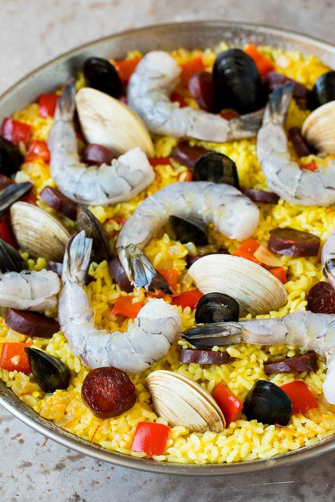Raw seafood on a bed of saffron rice.