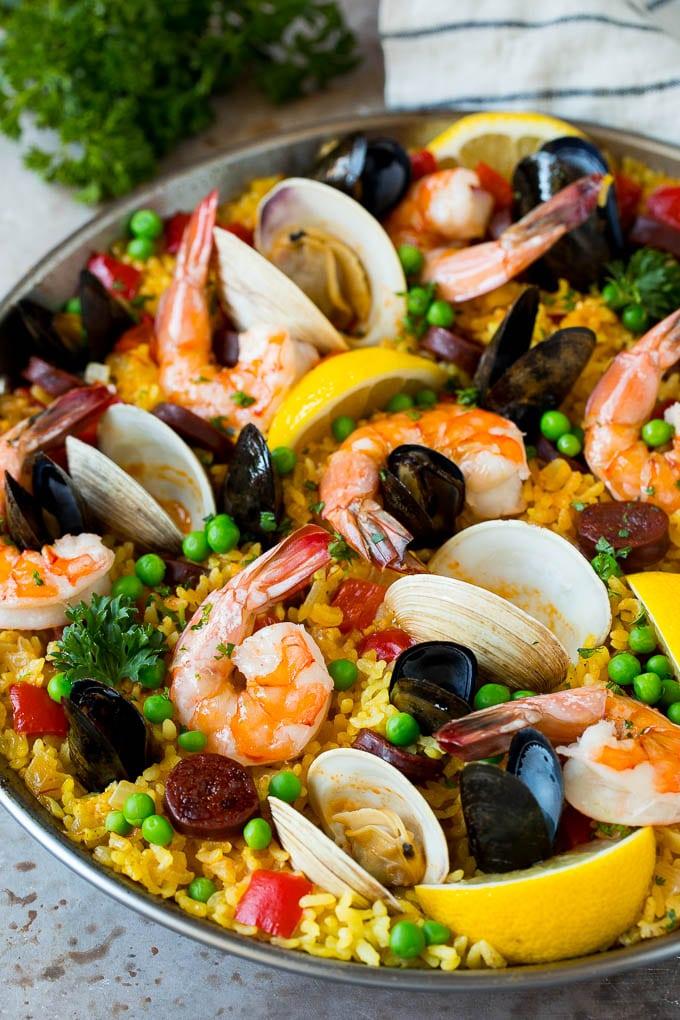 Seafood paella with shrimp, shellfish and sausage.