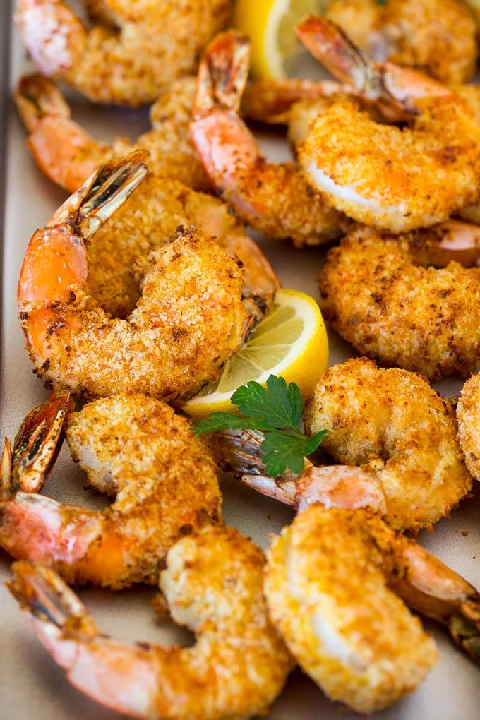 Air fryer shrimp garnished with lemon and parsley.