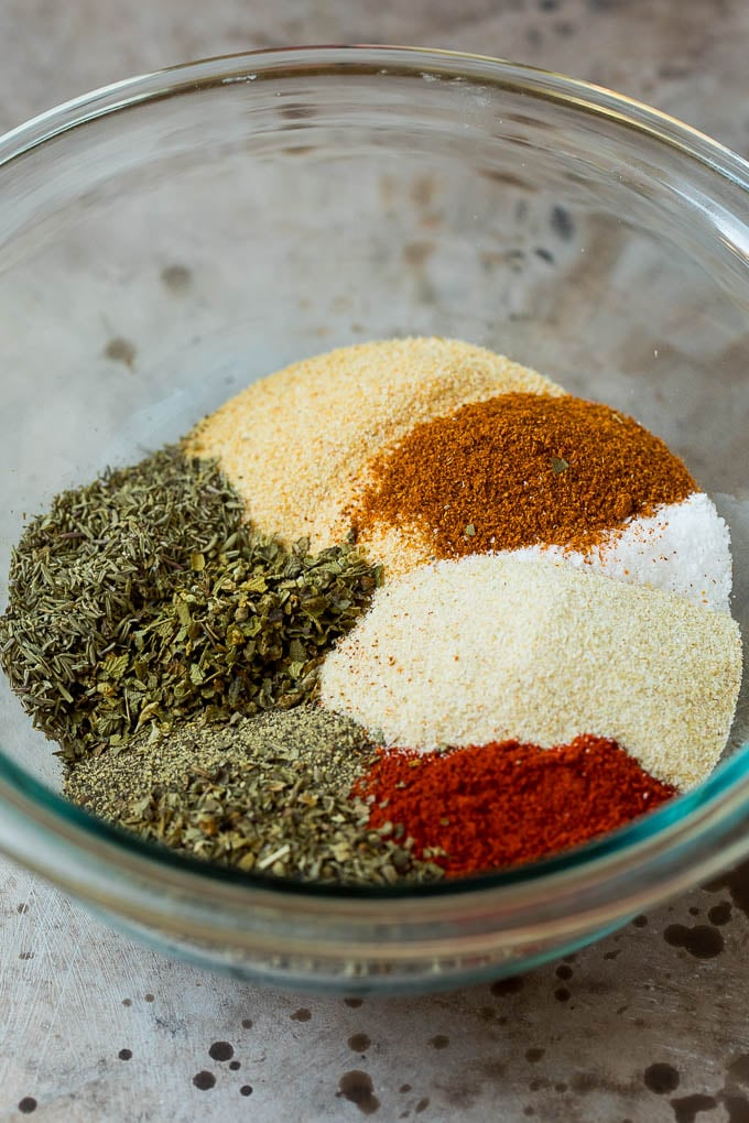 A bowl full of different dried herbs and spices.
