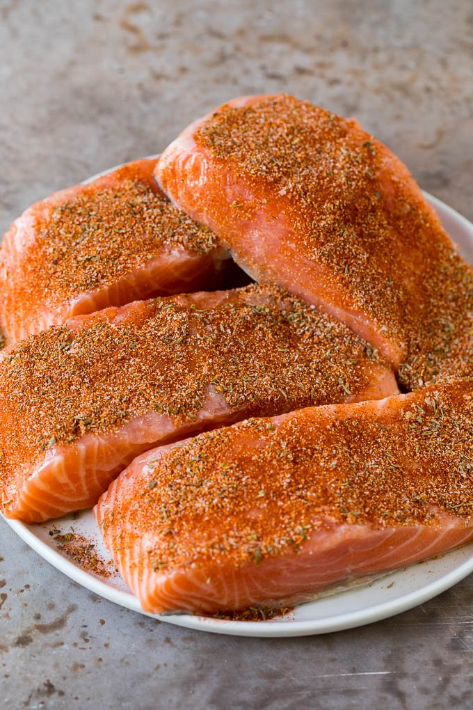 Salmon fillets coated with seasonings.