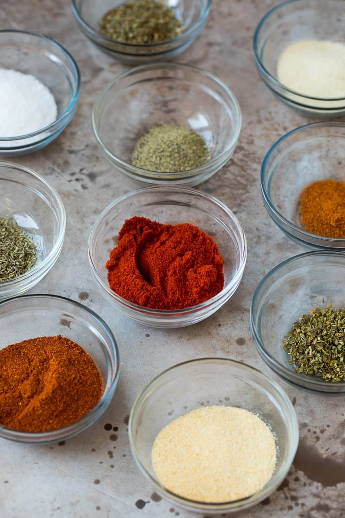 Small bowls of herbs and spices.