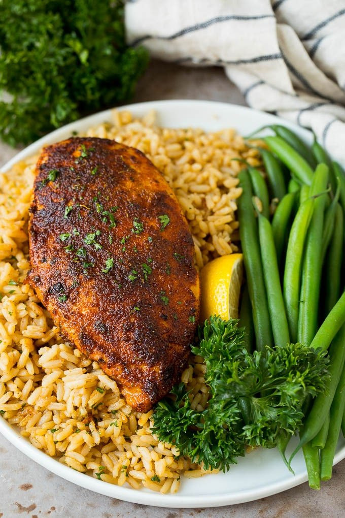 Blackened seasoning on chicken breast served over rice.