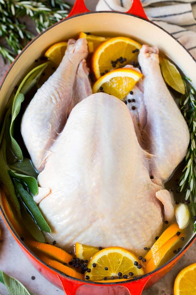 How to brine a turkey with a raw turkey in a pot of brine.