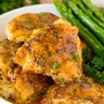 Instant Pot chicken thighs with gravy, served with asparagus.