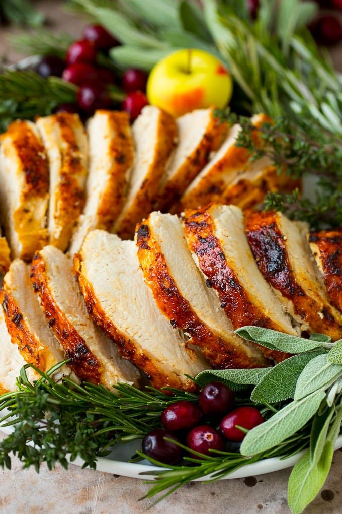 Cooked Instant Pot turkey breast sliced and served on a platter.