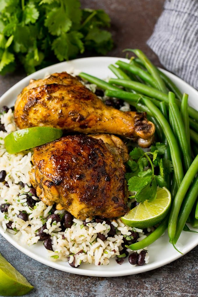 Jerk chicken marinade on cooked chicken over rice and beans.