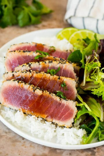Seared ahi tuna served with rice and salad.