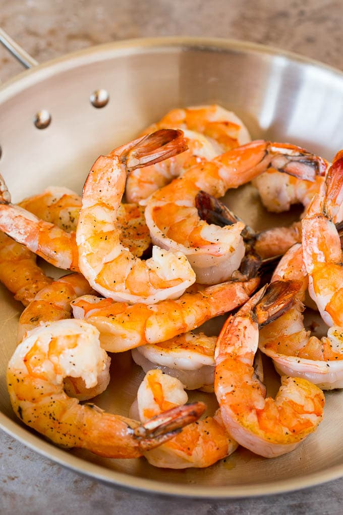 Cooked shrimp in a pan.