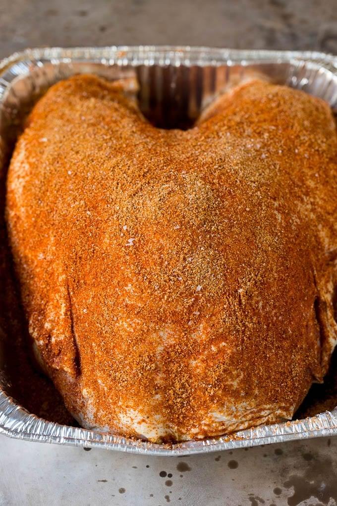 Turkey coated in homemade spice rub.