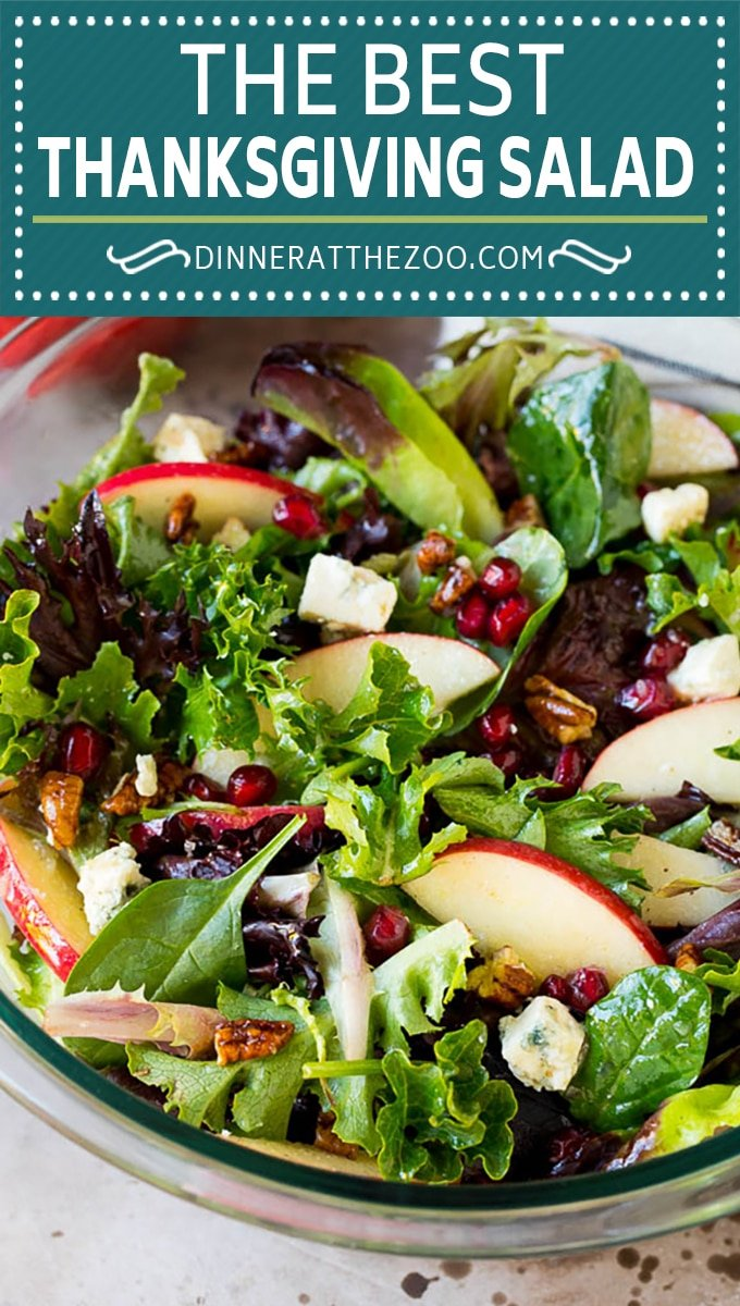 This Thanksgiving salad is a blend of mixed greens, fresh apples, pomegranate seeds, blue cheese and candied pecans, all tossed in a homemade vinaigrette.