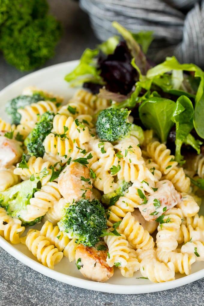 Chicken broccoli Alfredo pasta served with salad.