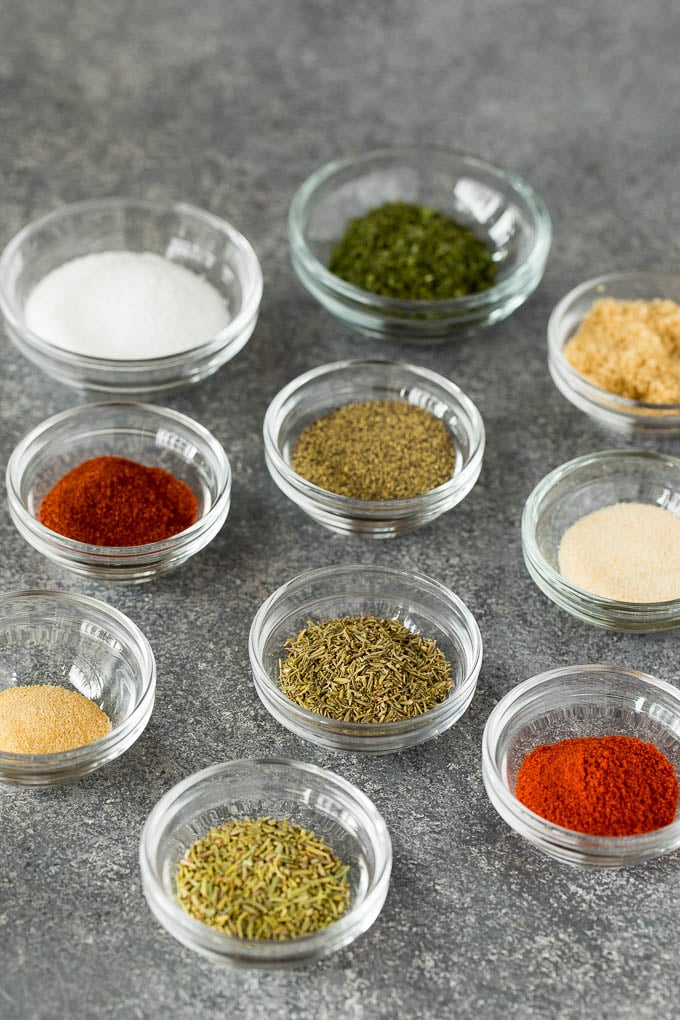 Small glass bowls of herbs and spices.