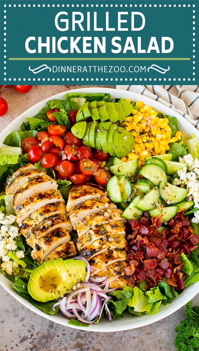This grilled chicken salad is tender marinated chicken that's grilled to perfection then served over lettuce with bacon, avocado, corn, blue cheese and tomatoes.