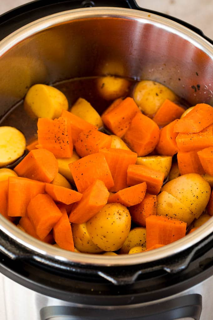 Carrots and potatoes in a pressure cooker.