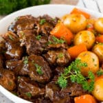 Instant Pot pot roast with carrots and potatoes, all topped with parsley.