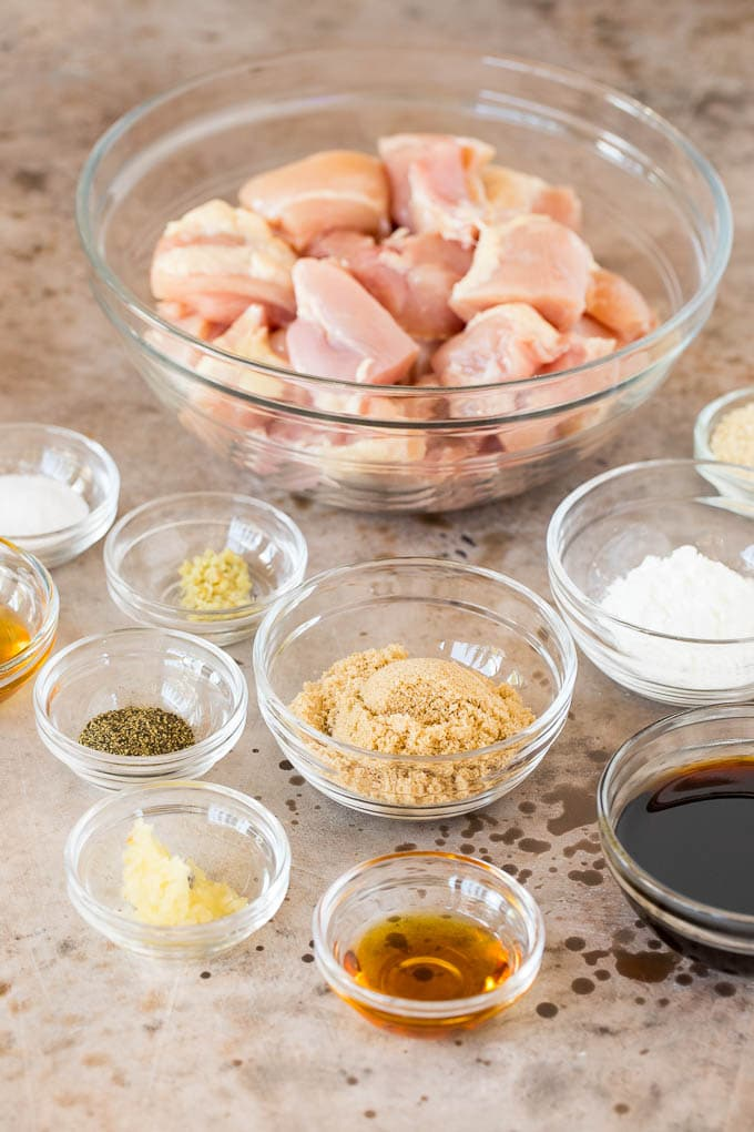 Bowls of ingredients including chicken, soy sauce, brown sugar and garlic.