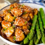 Instant Pot teriyaki chicken served with asparagus.