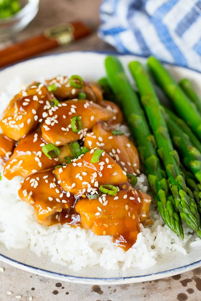 A plate of Instant Pot teriyaki chicken on rice.