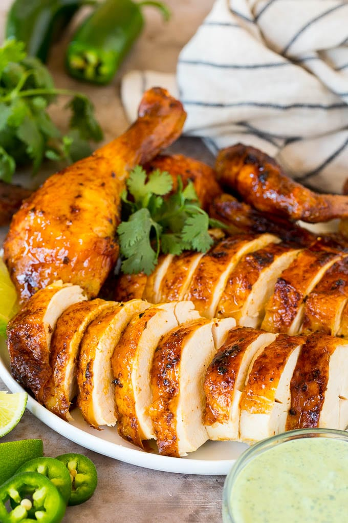 Sliced Peruvian chicken with lime, cilantro and a creamy sauce.