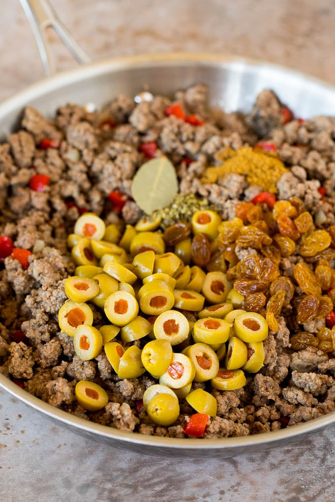 Cooked ground beef with olives, raisins and spices.
