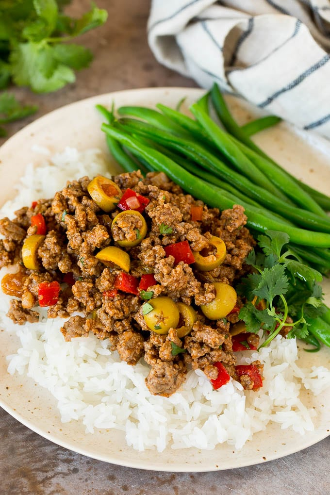 Picadillo served over rice with a side of green beans.