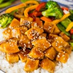 Teriyaki chicken bowl with vegetables served over rice.