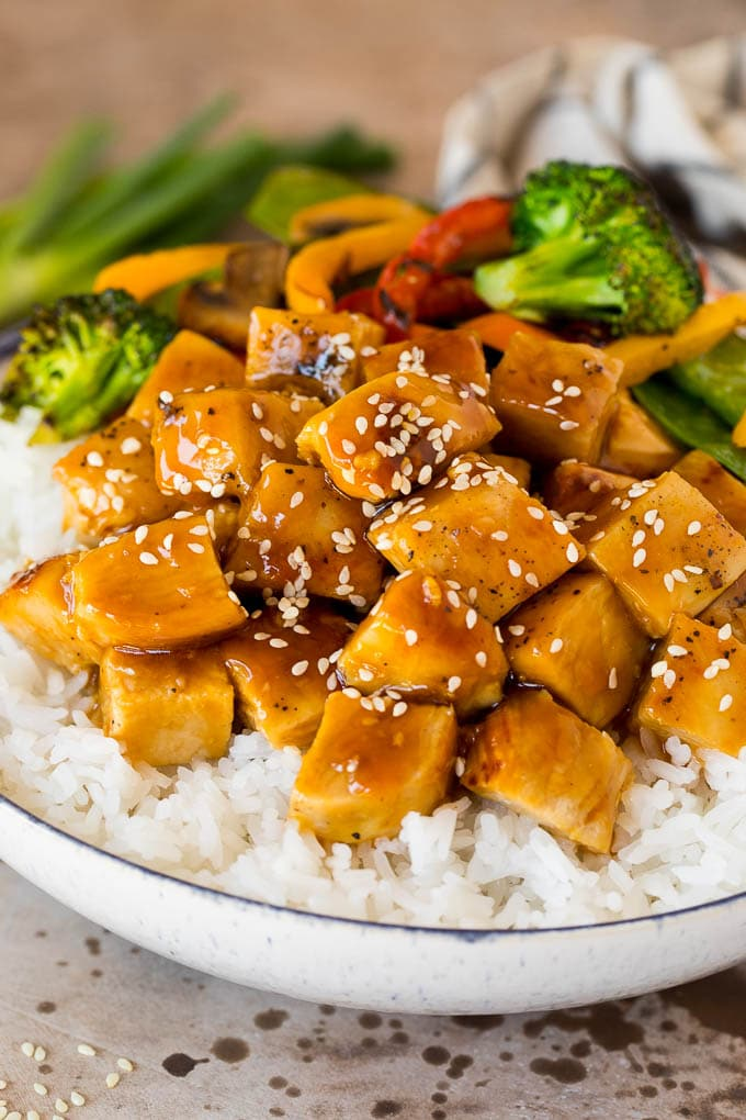 Teriyaki sauce on diced chicken served with rice and vegetables.