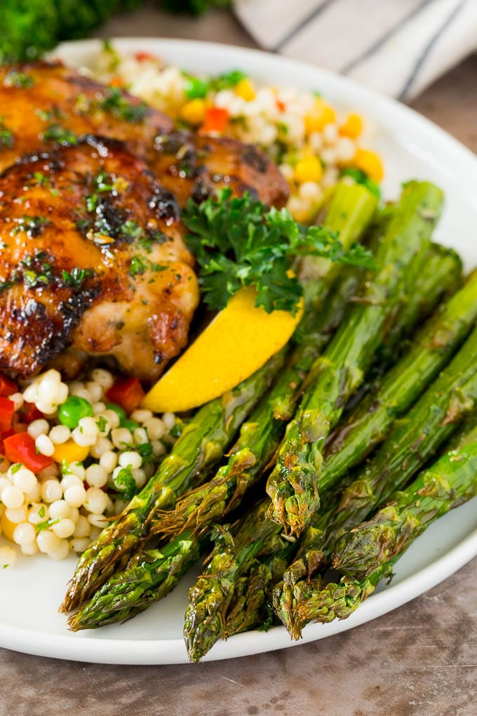 A serving of air fryer asparagus with couscous and chicken.