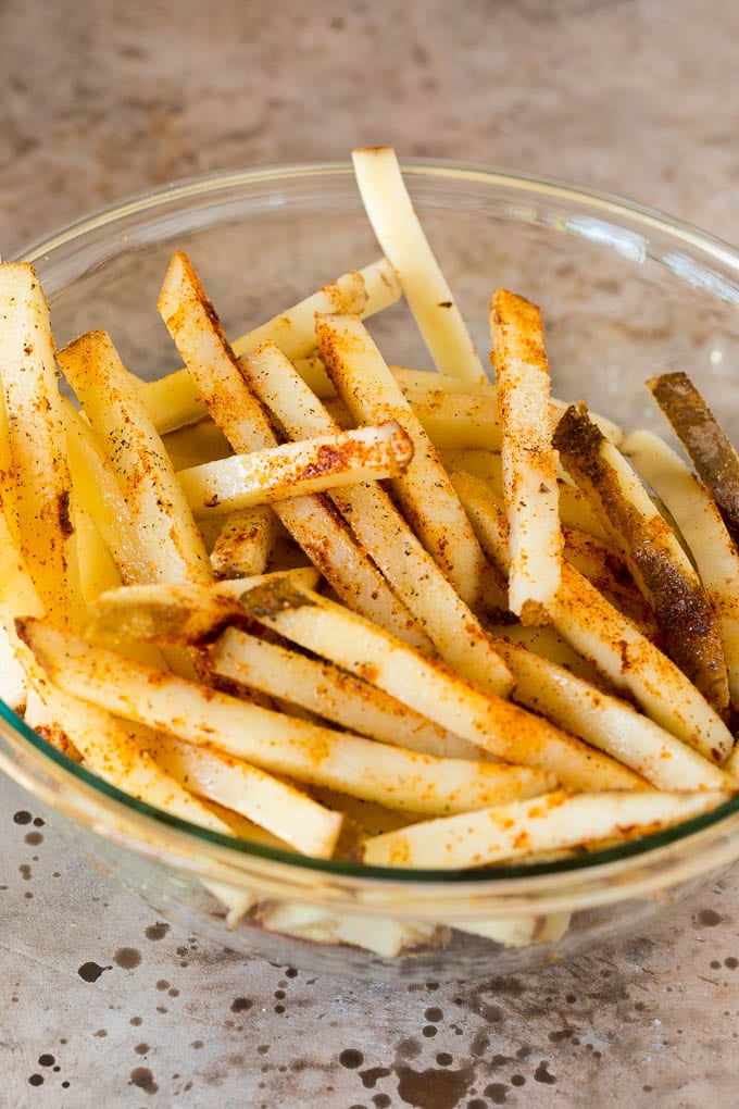 Potato sticks coated in spices and vegetable oil.