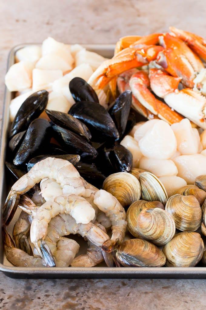 A sheet pan of assorted seafood and shellfish.