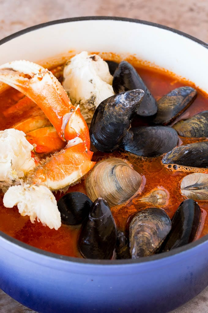 Crab, mussels and clams in a pot of tomato broth.