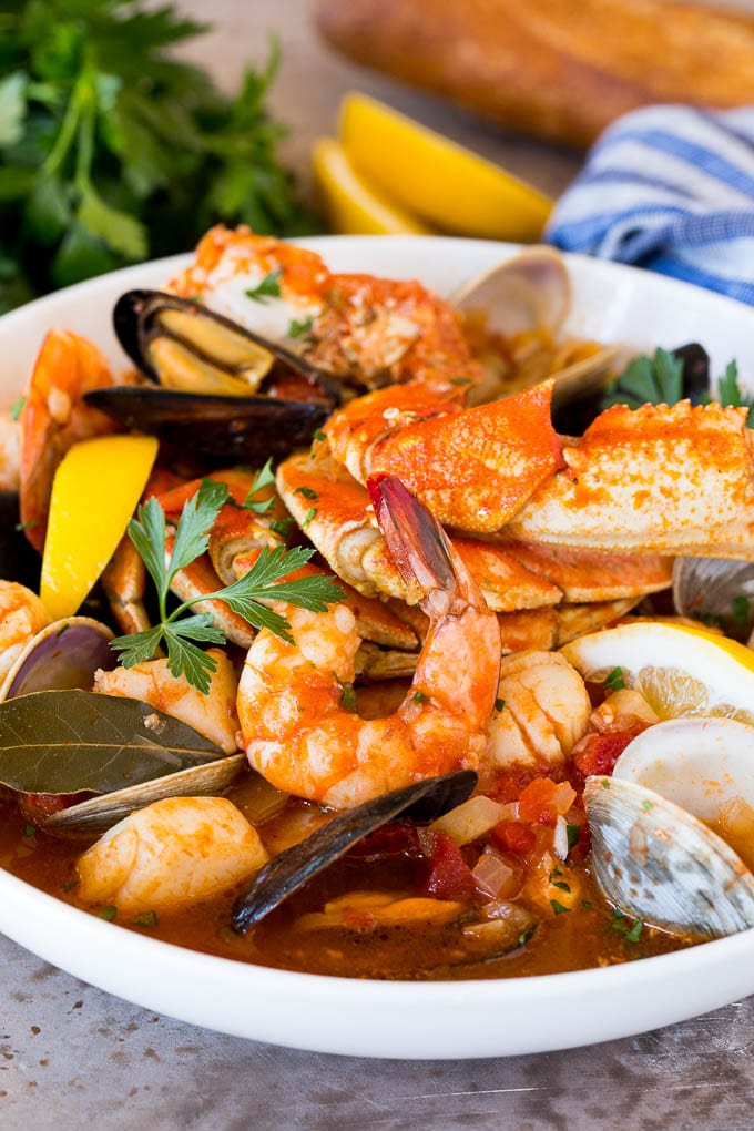 A large bowl of cioppino with crab, shrimp and shellfish.
